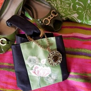 Small silk wristlet w/ embroidered flowers